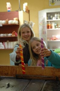 little girls making candles in them midlands