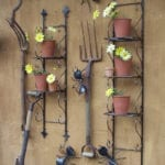 potting plants set up on a wall stand